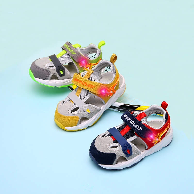 DINOSKULLS Toddler Baby Sandals LED Dinosaur Kids Trainers Front Toe Closed 2 Boys First Walking Summer Sandals Soft Beach Shoes