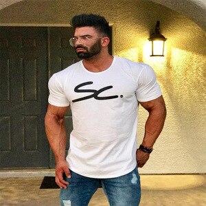 Мужская футболка для фитнеса HETUAF, футболка с коротким рукавом для тренажерных залов, обтягивающие штаны