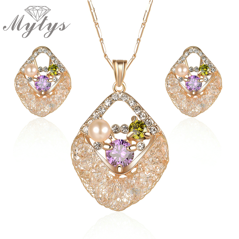 Mytys Fashion Pearl Crystal Pendant Necklace and Earring Sets Wire Mesh Net Crystal Sets Jewelry for Women CN291Mytys Fashion Pearl Crystal Pendant Necklace and Earring Sets Wire Mesh Net Crystal Sets Jewelry for Women CN291