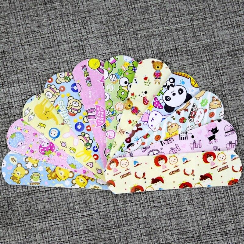 Купить с кэшбэком 100Pcs Children Dreathable Waterproof Wound Patch Cartoon Waterproof Bandage Band-Aid Hemostatic Adhesive For Kids Children