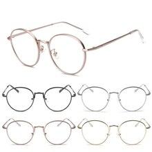 NOVA Moda Do Vintage de Metal Oval Óculos de Lente Clara Óculos Mulheres  Homens Quadro Artístico Simples Novo a8a166443c