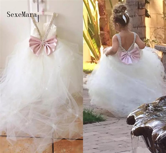 Flower Girls Dresses For Weddings Beaded Spaghetti Pleated Tulle Cute Pink Bow First Communion Dresses Pageant Dresses For GirlsFlower Girls Dresses For Weddings Beaded Spaghetti Pleated Tulle Cute Pink Bow First Communion Dresses Pageant Dresses For Girls