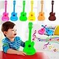 2016 venta caliente 4 cuerdas ukulele guitarra de juguete de plástico estilo británico educational toys para niños