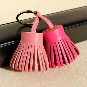 Image 3 - Llavero para las llaves del coche con borla de cuero genuino, llavero de lujo de marca famosa, bolso de mujer, colgante de mochila