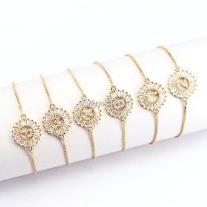 Image 1 - 12 Stücke Kupfer Pflastern Einstellung CZ Kristall Brief Armbänder Runde Form Schmuck Einstellbare Armband Für Frauen