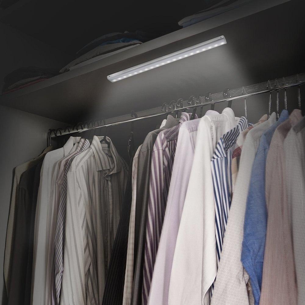 20 LED Cabinet lights PIR Motion Sensor Led Wardrobe Light With Adhesives Sticker LED Lamp Cupboard Closet Kitchen Light in Under Cabinet Lights from Lights Lighting