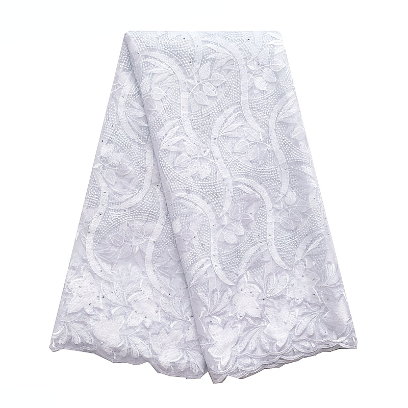 White lace fabric with stones
