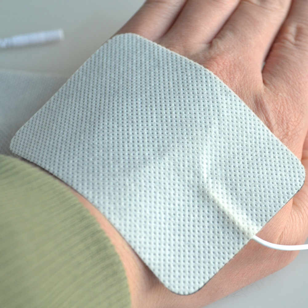 1 par Terapia Massager Pads Eletrodo Unidade Dezenas Estimulador de Nervo Não Tecido Gel de Silicone Elétrica Plug Patch 2mm Com 6x9cm