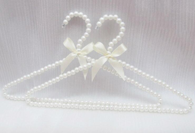 New arrival pearl plastic adult hanger clothes rack coat sweater dress hangers white bowknot hnagers accessories
