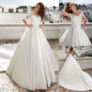Image 1 - Eenvoudige Satin Jewel Hals A lijn Trouwjurk Met Kant Applicaties & 3D Bloemen Half Mouwen Bruidsjurken Gown