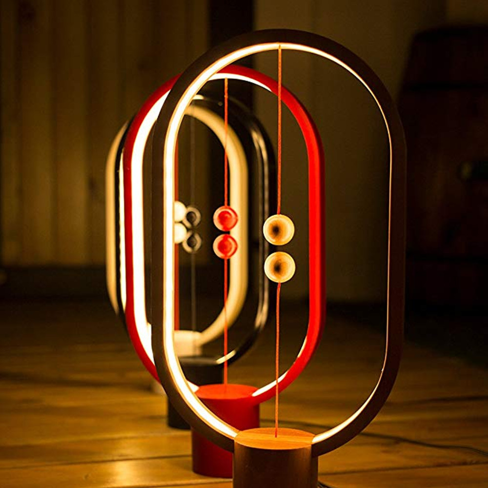 Dropshipping. exclusivo. DC5V 5 W 48LED Heng Balance LED de la lámpara de mesa elipse magnético de interruptor de aire USB blanco cálido luz de la noche