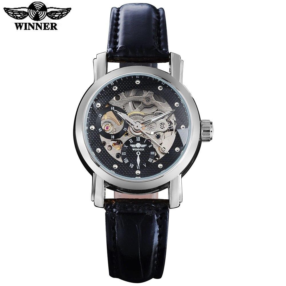 afdd883b5ce9 2016 ganador famosa marca mujeres moda reloj automático viento reloj  esqueleto Dials transparente de cristal caso de plata banda de cuero