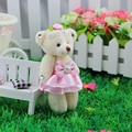 The latest doll key chain with diamond pendant wholesale Jingyi teddy bear doll cartoon bouquet joint material