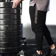 Uomini Sottile di Cotone Con Coulisse Pantaloni Della Tuta Pantaloni di Fitness Uomo Jogger Allenamento casual Moda della Mutanda Pantaloni Della Matita di Marca di Abbigliamento Sportivo