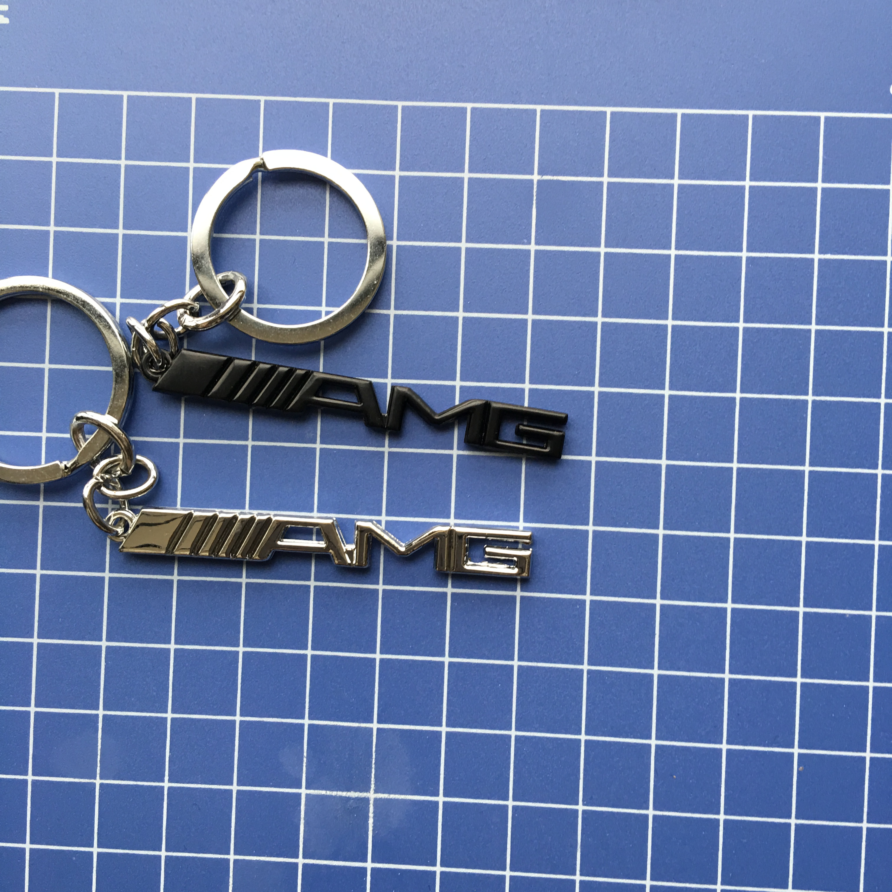 Popular amg key chain buy cheap amg key chain lots from for Mercedes benz tire chains