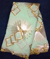 Au détail chine vendeur brodé dentelle tissu de haute qualité Paillettes lacets de voile suisse 2017 tissu africain pour les femmes