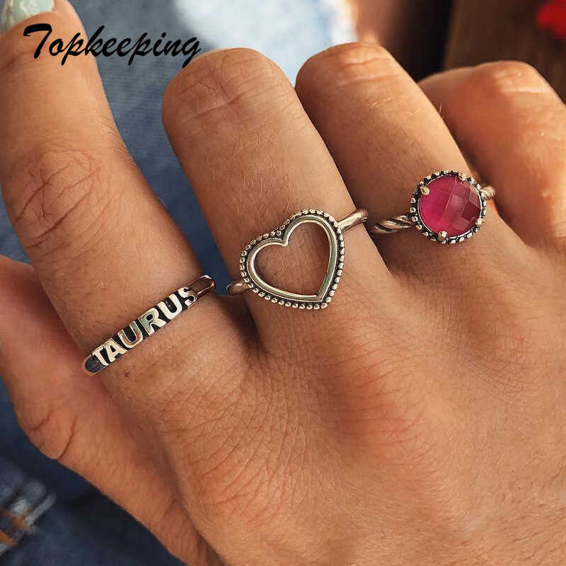 Taurus แหวนชุดเครื่องประดับ Heart Shaped Hollow ออกแบบสีแดงคริสตัลหลายแหวน Vintage Alloy อุปกรณ์เสริมชุดแหวน