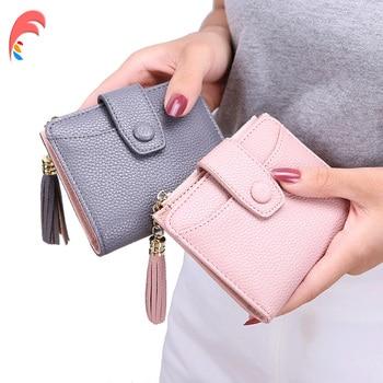 Mały portfel z paskiem i frędzlami