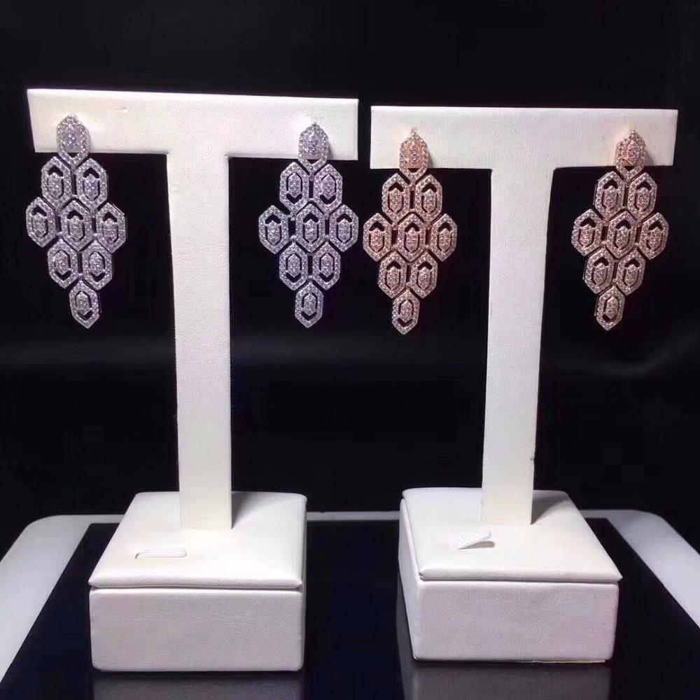 Qi xuan_joaille_nouvelles boucles d'oreilles géométriques boucles d'oreilles S925 argent incrusté Zircon élégant et irrégulier irrégulier _ ventes directes d'usine