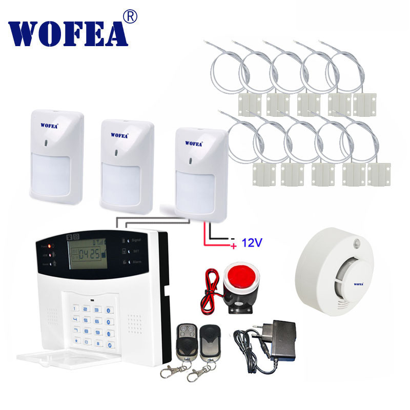 Livraison gratuite kit de système d'alarme LCD GSM zone filaire avec capteurs filaires pour capteur de porte détecteur de mouvement détecteur de fumée