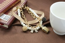 The new perfume bottle for girls is decorated with pearl ribbon crystal bracelet with bow chic faux pearl decorated geometric bracelet for women