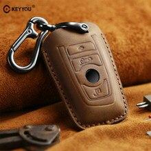 KEYYOU de cuero genuino bolso de la llave del coche caso clave para BMW X1 X3 X4 X5 1 3 5 7 Serie F25 F26 F34 F07 F80 F82 F30 F31 F32 E90 E91 E92