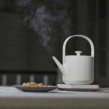 Novo design simples 600 ml capacidade da caldeira de água 1200 w chaleira elétrica de ebulição rápida bule de café de chá com alça de desligamento automático