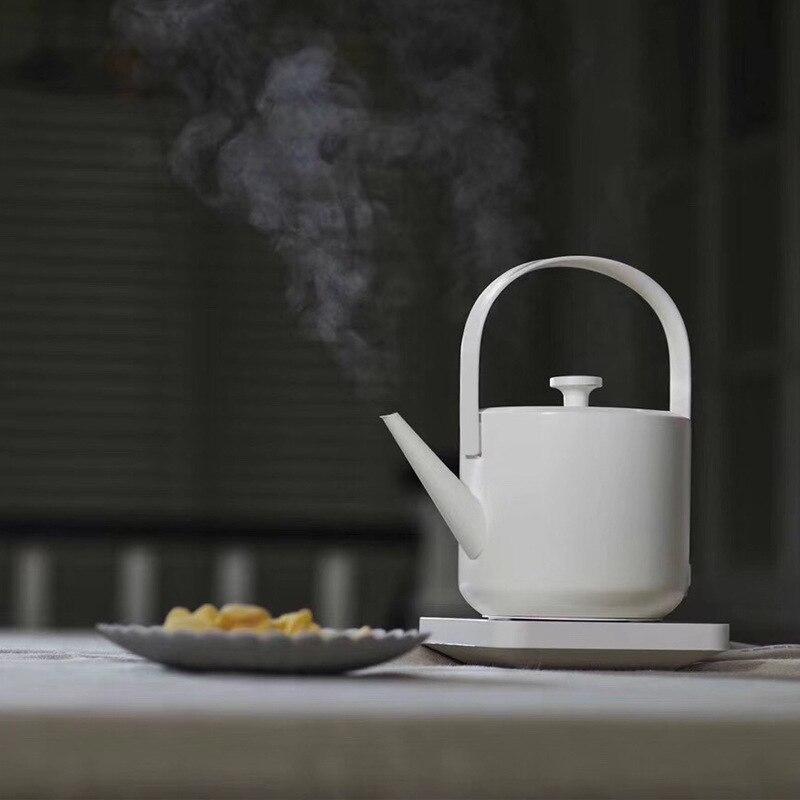 Nuovo Disegno Semplice 600 ml di Acqua di Capacità Caldaia 1200 w Veloce Bollente Bollitore Elettrico per Tè e Caffè Pentola con Manico Automatico power-off