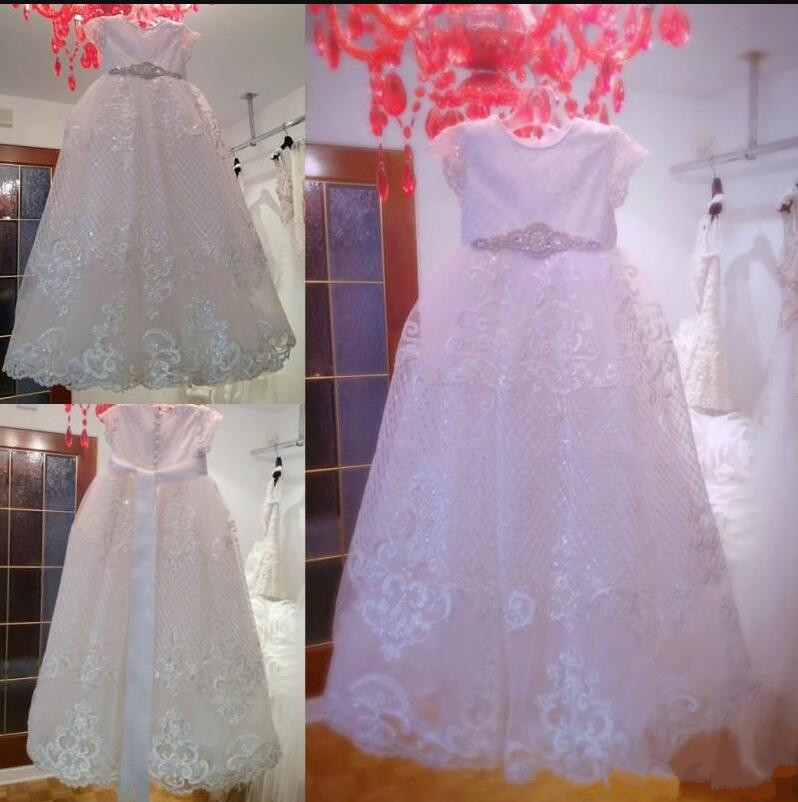 White Tulle holy First Communion Gowns with Belt Sequins Cap Sleeves Customized Flower Girl Dress For Special Occasion  White Tulle holy First Communion Gowns with Belt Sequins Cap Sleeves Customized Flower Girl Dress For Special Occasion