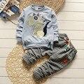 2016 Do Bebê Roupas Das Meninas Dos Meninos Terno T-shirt 2 pçs/set Dinossauro Dos Desenhos Animados Da Moda Outono Calças Longo-manga comprida Xadrez 1-5y Crianças