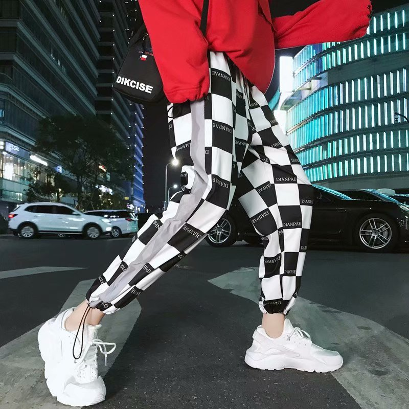 Men's Reflective Sports Pants Plaid Casual Pants 2019 Woman Reflective Strip Loose Harlan Beam Foot Jogging Pants Men Clothing