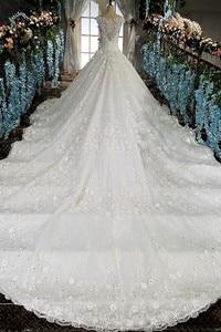 Image 5 - LS00158 vestido de noiva durchsichtig zurück appliques kappen hülsen spitze ballkleid sicke spitze Luxus brautkleider echt fotos