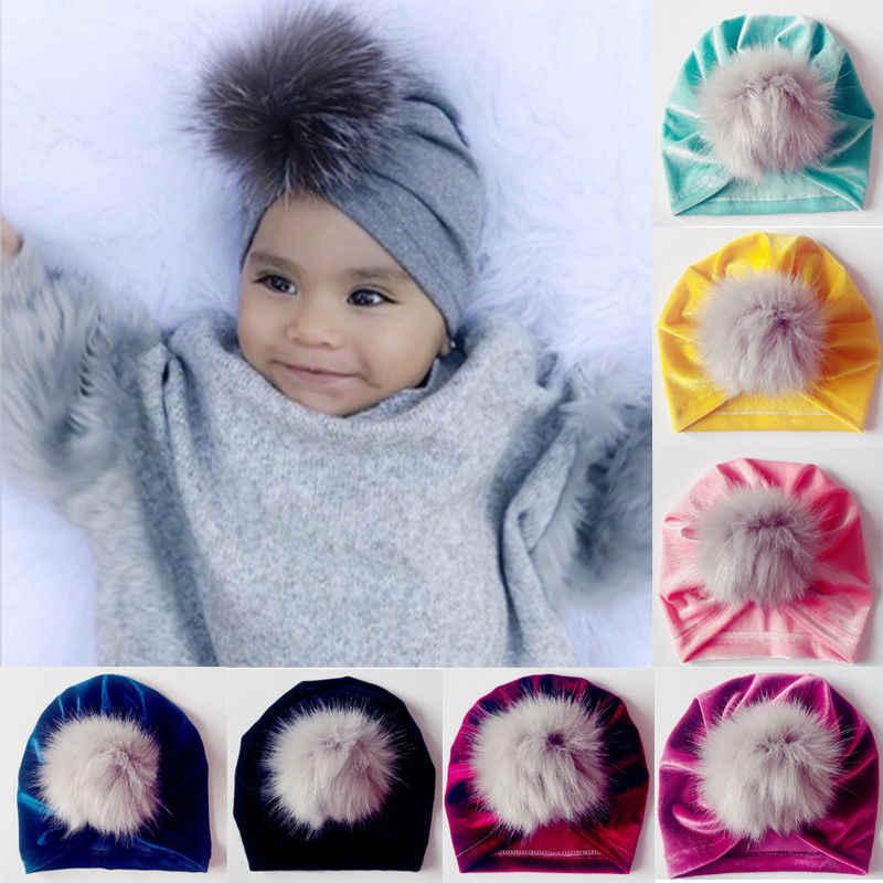 30714ea664b1a6 2018 New Newborn Infant Baby Girls Boys Pom pom Hats Fur Balls Turban  Velvet Beanie Hat