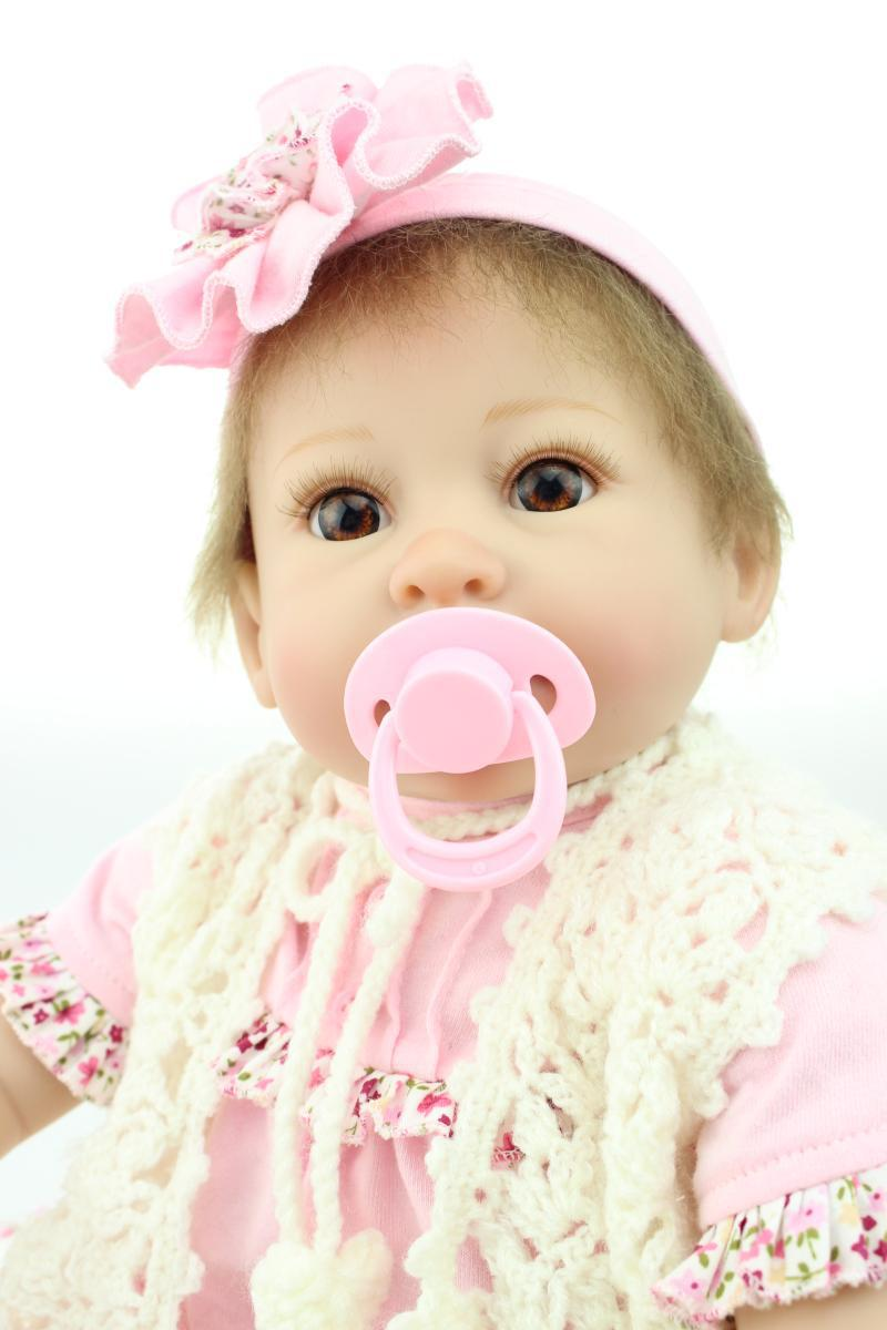 все цены на 55cm 22 inch pink silicone reborn baby doll toys for girl, lifelike reborn babies play house toy birthday gift girls brinquedos