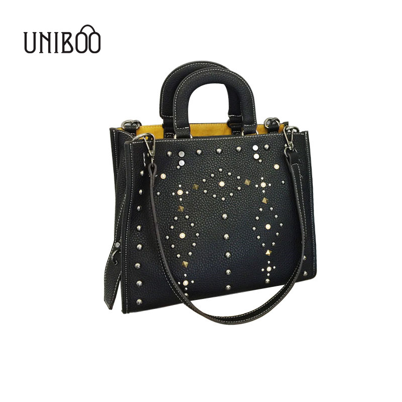 ФОТО European and american style women big rivet tote hangbag personality large capacity female punk cool black single shouler bag