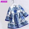 2017 novo vestido da menina primavera outono azul meninas vestido branco da porcelana high-end da marca de impressão longo-manga A Linha frete grátis