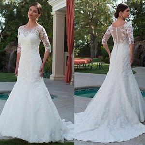 Image 1 - Elegante tule bateau decote sereia vestido de casamento com apliques de renda frisada meia mangas vestido de noiva com cristais