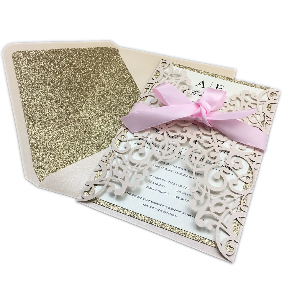 Us 47 6 15 Off Free Shipping 50x High End Light Pink Wedding Invitation Card Laser Cut Floral Glitter Invitations With Envelope Ribbon In Cards