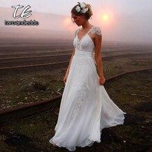 V ネックバックレスのウェディングドレスジッパーバックキャップスリーブレースアップリケ a ラインの花嫁衣装裁判所の列車と弓