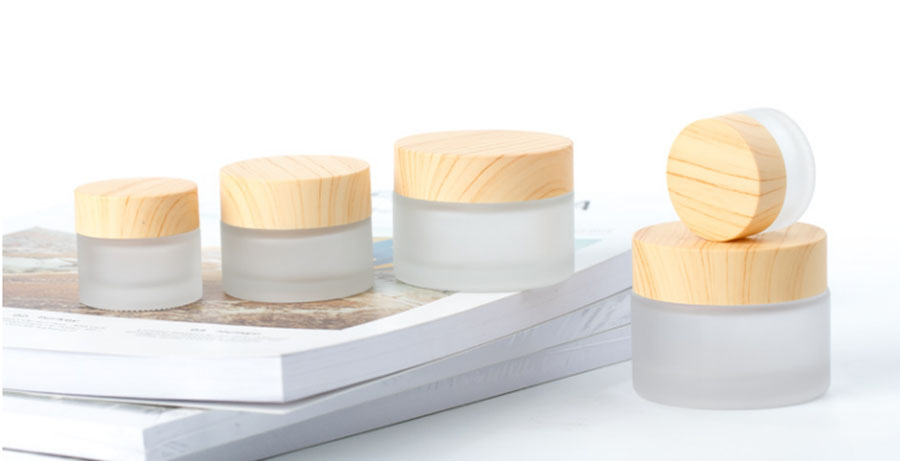 New Design 12 X 50g 30g 15g 10g 5g Frost Glass Cream Jar With  Plastic Imitation Wood Lids 1/2oz 1/3oz 1oz Glass Containers