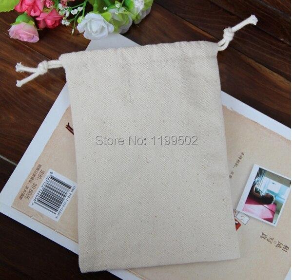 5a3061786d4 Alta calidad 7 9 cm overlocked bolsos de la lona del lazo para el grano de  café ornamento regalo joyería reloj bolsa bolsa por encargo