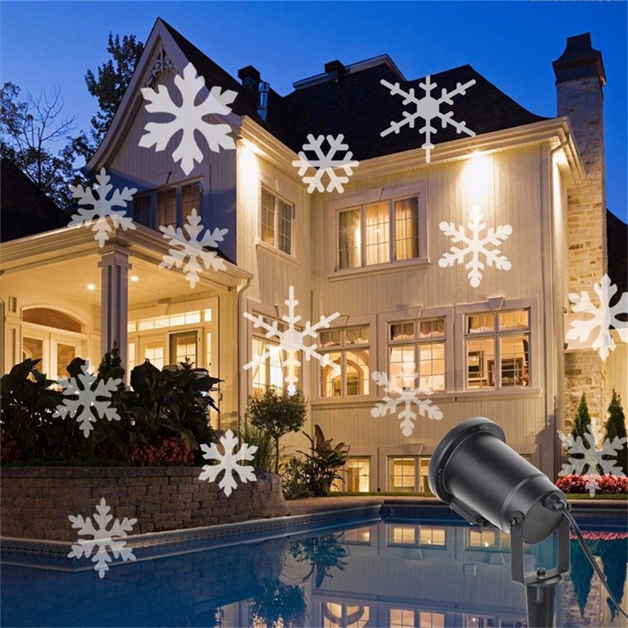 цена на ZINOU Outdoor Waterproof Moving Snow Laser Projector Winter Snowflake Spotlight LED Stage Light For Christmas