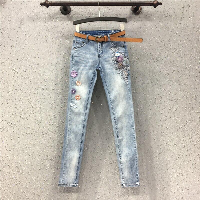 Nouveaux Jeans femmes Europe Station mode ongles perle stéréo fleur Slim crayon pantalon