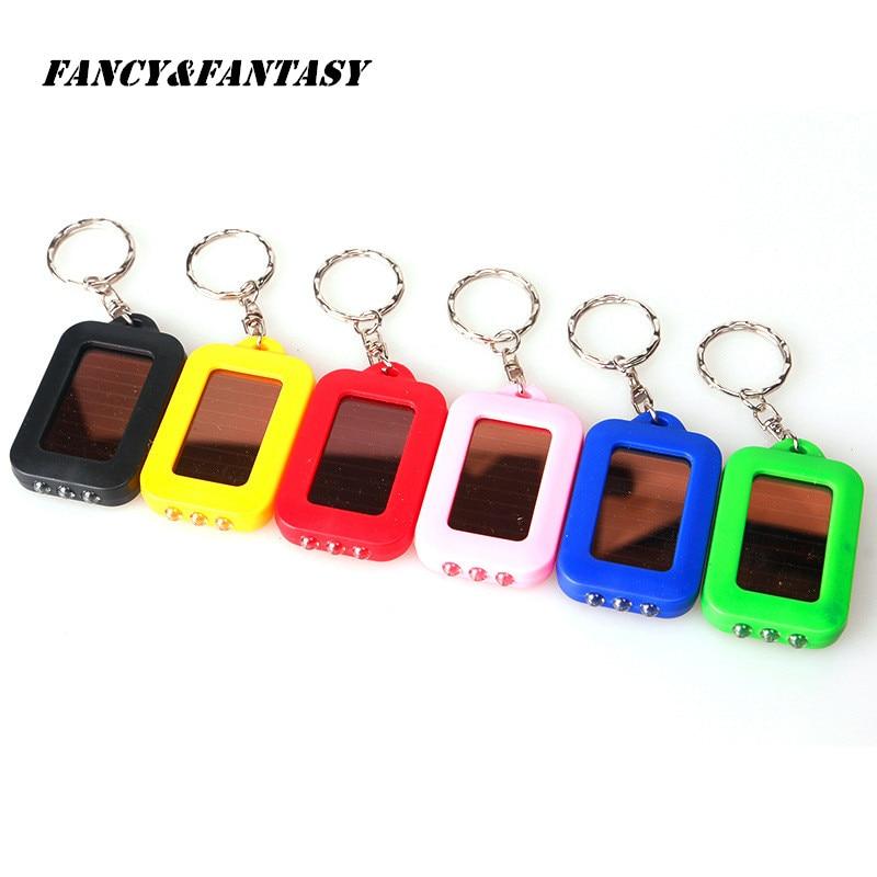 Fancy&Fantasy New Mini Portable Solar Power Energy Rechargeable LED Flashlight Keychain Emergency Light Ring Holder Colors