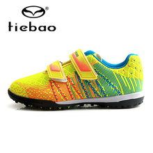 цена на TIEBAO Children's Football Boots Football Sneakers Soccer Shoes Top Quality TF Turf Rubber Soles Sneakers Soccer Sport Shoes