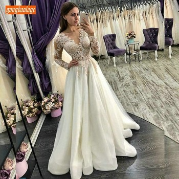 Sexy Transparent Lace Top Appliqued Beaded Wedding Dresses Long Sleeve 2019 Elegant Tulle A-Line Celebrity Ivory Wedding Gowns
