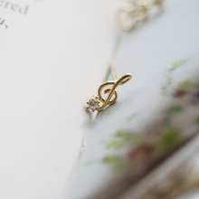 купить women stud earrings 14k gold female Korean bling zircon Czech violin note stud earrings fine jewelry accessories earrings girl по цене 2286.11 рублей