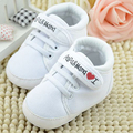 Letra de la impresión suave únicos zapatos del niño para los bebés lactantes 0-18 m bebé Infantil Niños Niño Niña Suela de Lona Zapatilla de deporte de Niño Recién Nacido zapatos