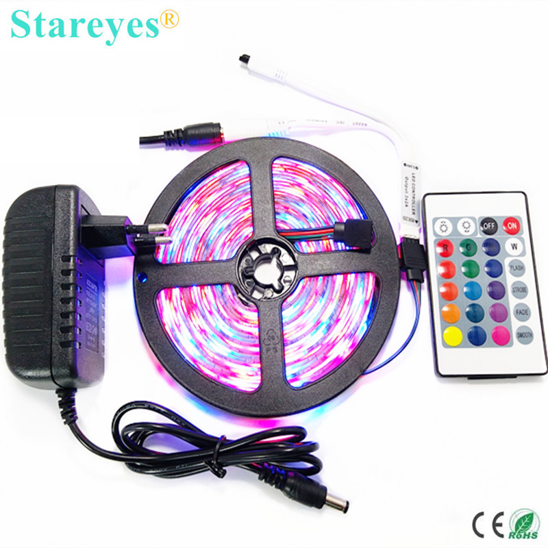 1 sett 5M SMD 3528 2835 300 LED RGB LED Stripe lampe tape LED Light Vanntett lysstripe + IR Remote + 2A Strømadapter