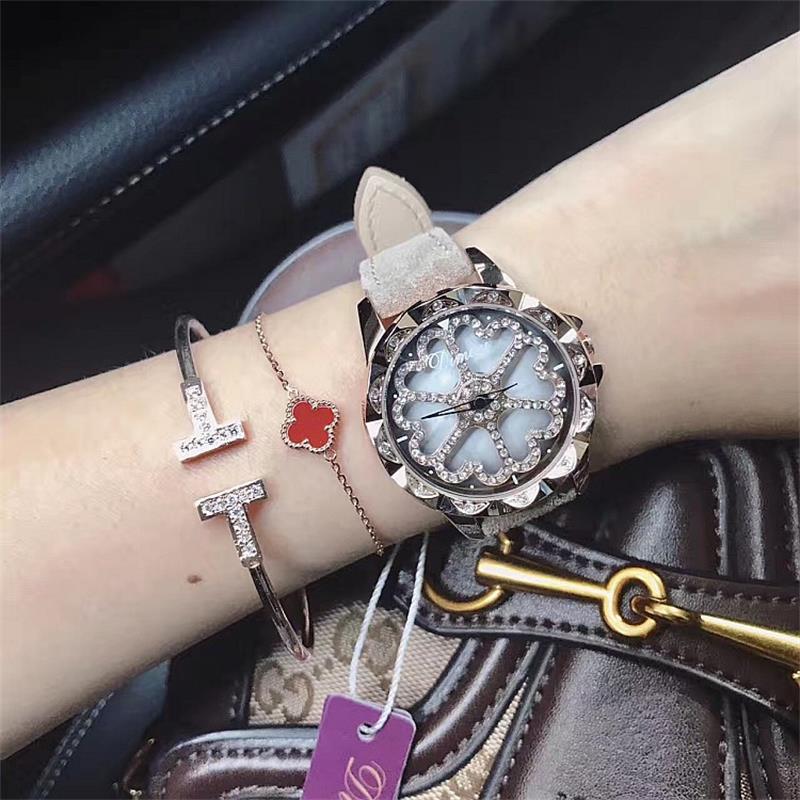 Top qualité de luxe dame cristal montre femmes robe montre. mode en peluche véritable cuir Rotation femme coeur forme montres